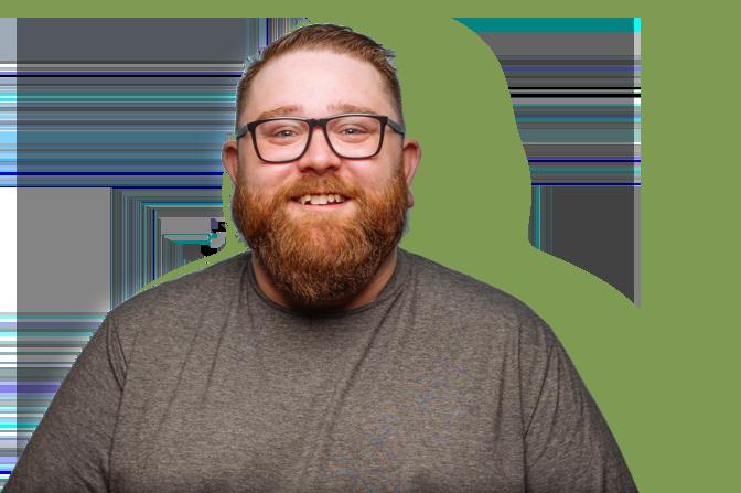 Lachende man met baard en bril